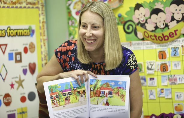 C.K. Carter, 37, author, mother and teacher, at a reading of her children books, The Castle Across the Street and Silly Dog Gus, Oct. 08, 2014 at the Little Place pre-school in Wellington. Carter is writing Jackson's First Day of School a sequel to her first book. (Bill Ingram / Palm Beach Post)