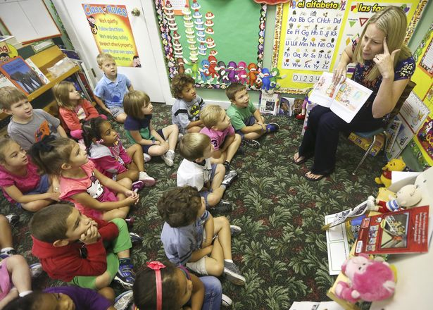 C.K. Carter reads her award-winning book, The Castle Across the Street, to students at the Little Place pre-school in Wellington on Oct. 8, 2014. (Bill Ingram / Palm Beach Post)