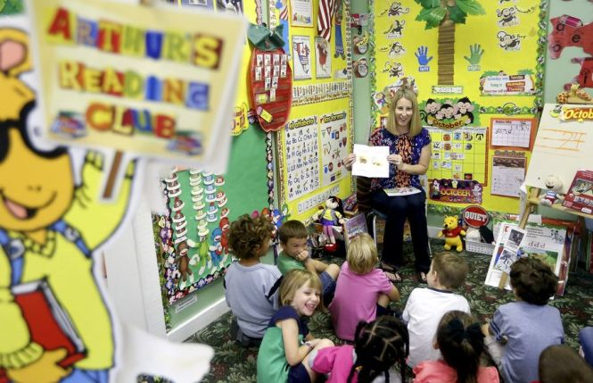 C.K. Carter reads her second book, My Silly Dog Gus,  to students at the Little Place pre-school in Wellington on Oct. 8, 2014. (Bill Ingram / Palm Beach Post)